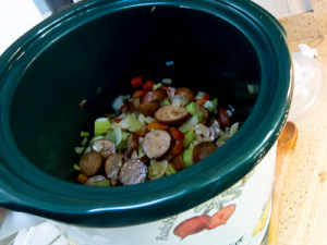 Add sausage and cooked vegetables to Slow Cooker